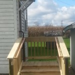 Walker Steps on side entrance of the home with Bilateral wood hand rails