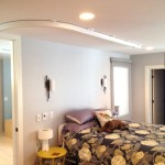 SureHands Ceiling Track Lift System through Bedroom to Bathroom for safe, independant transfers